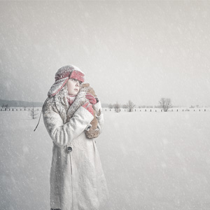 Young girl in a covered-snow field (Rawdon)